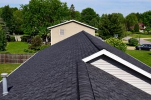Dennison Exterior Solutions & Gutter Topper Installed CertainTeed's LandMark Pro Moire Black Shingles