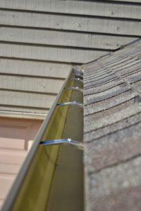 Inside Seamless Gutter Hangers Install by Dennison Exterior Solutions & Gutter Topper