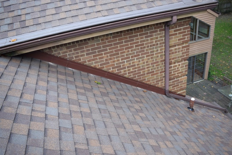Saint joseph michigan roof and gutter cover project dennison exterior solutions for Integrity roofing and exteriors