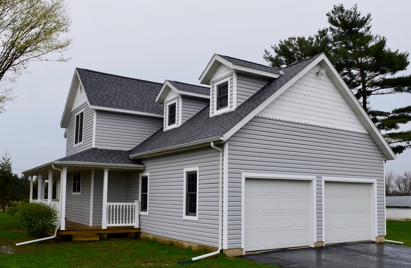 Baroda michigan roofing siding gutter topper project dennison exterior solutions for Integrity roofing and exteriors